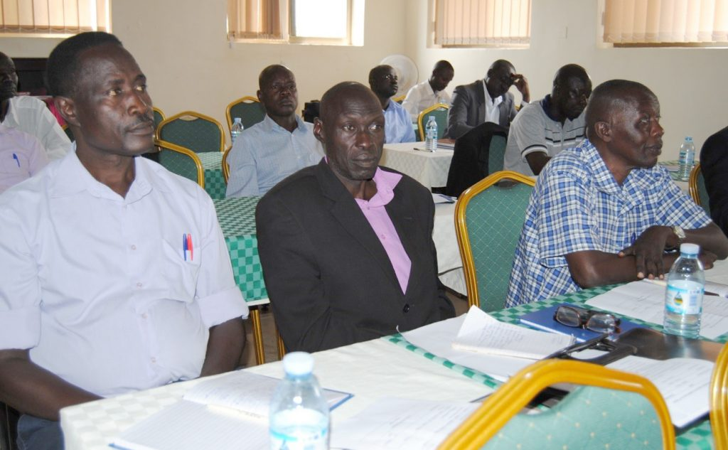Jonathan Maraka (left), an Iteso Cultural Union leader, listens attentively at the launch